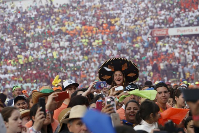 Youths cheer during a meeting with Pope Francis (not pictured) at the Jose Maria Morelos y Pavon stadium in Morelia, Mexico, February 16, 2016. (Photo by Carlos Garcia Rawlins/Reuters)