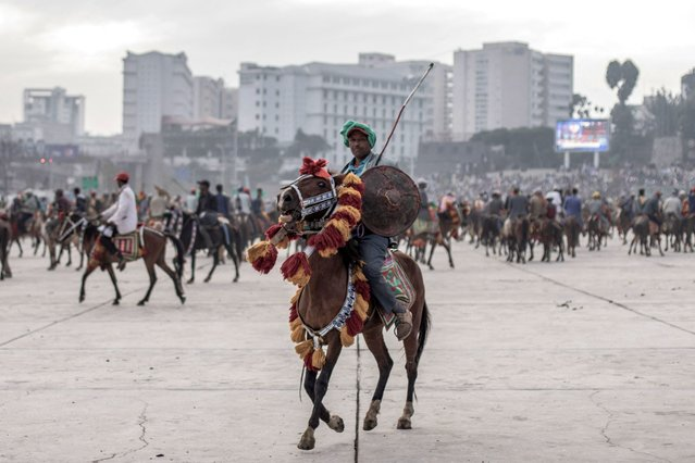 A horse rider attend a rally against pro-TPLF forces (Tigray People's Liberation Front) and to support for Ethiopia's armed forces in Addis Ababa on August 08, 2021. (Photo by Amanuel Sileshi/AFP Photo)