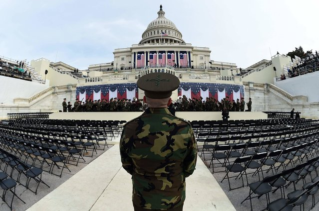 The United States Marine Corps Band practices in front of the podium where US President-elect Donald Trump will take the oath of office and be sworn in as the 45th US president in  Washington, DC on January 19, 2017. Twenty-four hours before he takes the oath of office as the 45th US president, Trump arrived in Washington on Thursday, determined to transform American politics over the next four years. (Photo by Timothy A. Clary/AFP Photo)