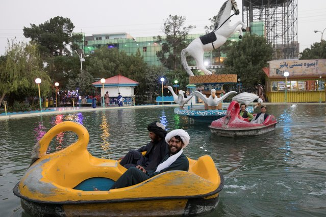 Afghan men ride pedal boats in a park in Herat, Afghanistan on September 10, 2021. (Photo by WANA (West Asia News Agency) via Reuters)