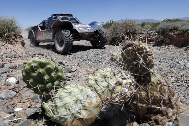 Buggy driver Carlos Sainz of Spain and co-pilot Timo Gottschalk of Germany races during the third stage of the Dakar Rally between the cities of San Rafael and San Juan, Argentina, Tuesday, January 7, 2014. (Photo by Jean-Paul Pleissier/AP Photo)
