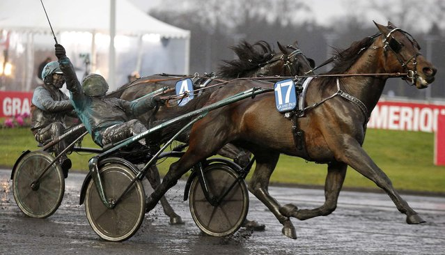 Sweden's Orjan Kihlstrom with his horse Maharajah celebrates as they cross the finish line to win the 93th Grand Prix d'Amerique trotting race at the Vincennes racetrack outside Paris, on January 26, 2014. (Photo by Christophe Ena/Associated Press)