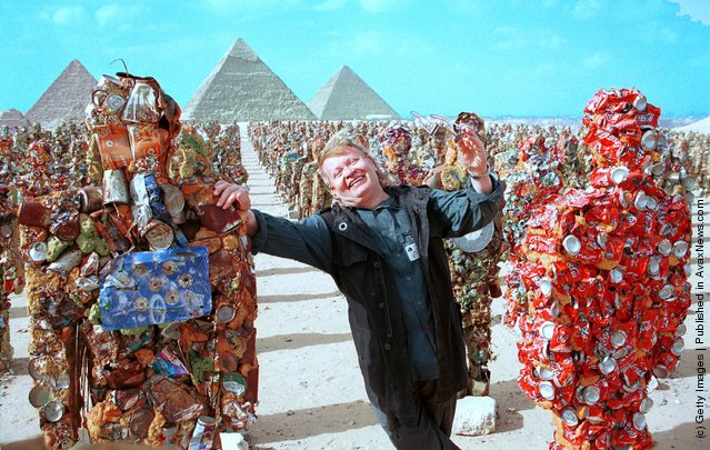 German artist Ha Schult stands with his trash people below the pyramids May 15, 2002 in Giza, Egypt