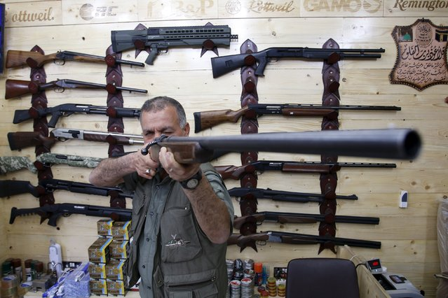 A man checks a hunting rifle at a shop for hunting weapons in Baghdad, Iraq March 17, 2016. (Photo by Khalid al Mousily/Reuters)