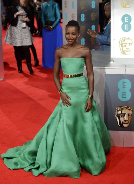 Kenyan actress Lupita Nyong'o arrives on the red carpet for the 2014 EE British Academy Film Awards ceremony at The Royal Opera House in London, Britain, 16 February 2014. (Photo by Facundo Arrizabalaga/EPA)