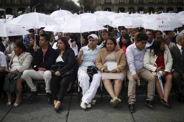 Bridal couples wait before a mass wedding ceremony in which 2,016 couples participated, at Zocalo square in Mexico City, Mexico, March 19, 2016. (Photo by Edgard Garrido/Reuters)