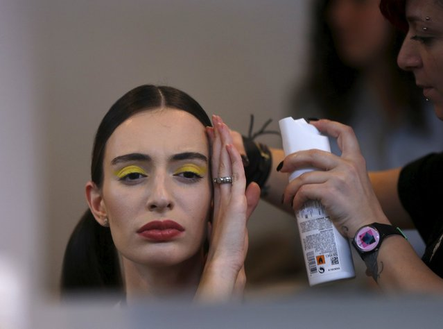 A model has her hair done backstage during the Mercedes-Benz Fashion Days in Tbilisi, Georgia, May 2, 2015. (Photo by David Mdzinarishvili/Reuters)