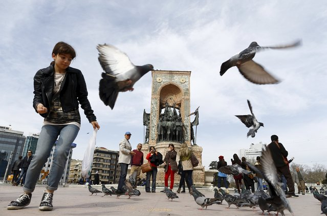 Local and foreign tourists stroll at Taksim square in central Istanbul, Turkey March 22, 2016. (Photo by Osman Orsal/Reuters)