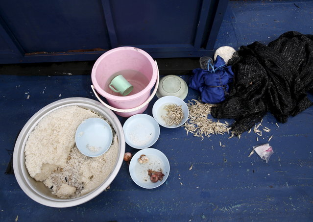 Food left behind on a boat that carried Rohingya migrants for three months is seen at Langkawi island, in Malaysia's northern state of Kedah May 12, 2015. (Photo by Olivia Harris/Reuters)