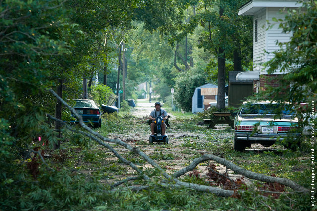 Branches litter an alley as a result of Hurricane Irene