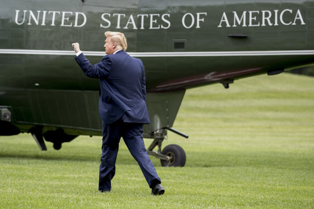 President Donald Trump walks on the South Lawn of the White House in Washington, Wednesday, May 8, 2019, to board Marine One for a short trip to Andrews Air Force Base, Md., to travel to Florida to visit with those affected by Hurricane Michael and attend a rally. (Photo by Andrew Harnik/AP Photo)