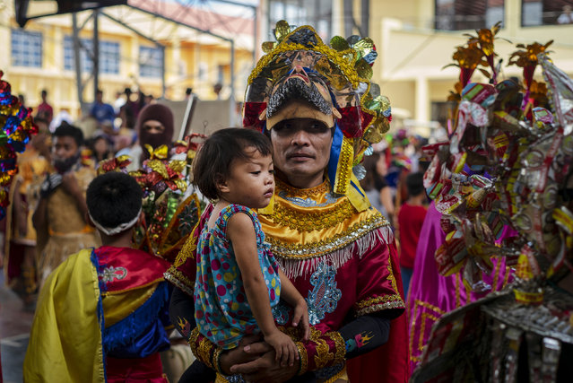 Residents dress up with colorful local version of Roman soldiers as they celebrate Easter Sunday on April 21, 2019 in Mogpog in Marinduque, Philippines. Christians worldwide celebrated Easter on Sunday, commemorating the day on which Jesus Christ is believed to have risen from the dead. Also known as Resurrection Sunday, Christians across the globe describe Easter in the New Testament having occurred on the third day of Jesus' burial after his crucifixion on Good Friday by the Romans at approximately 30 AD. (Photo by Jes Aznar/Getty Images)