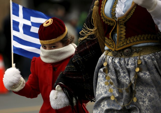 A girl, bound with a scarf from the cold, marches in the annual Greek Independence Day Parade on Danforth Avenue in Toronto, Ontario April 3, 2016. (Photo by Chris Helgren/Reuters)