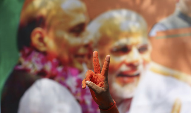 Bharatiya Janata Party (BJP) workers celebrate at BJP headquarters in, Lucknow, India, Thursday, May 23, 2019. Indian Prime Minister Narendra Modi and his party had a commanding lead as votes were counted Thursday after a six-week general election, sending the stock market soaring in anticipation of another five-year term for the Hindu nationalist leader. (Photo by Rajesh Kumar Singh/AP Photo)