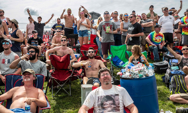 Race fans watch the 103rd race of the Indianapolis 500 at Indianapolis Motor Speedway on May 26, 2019 in Indiana. (Photo by Kerem Yucel/AFP Photo)