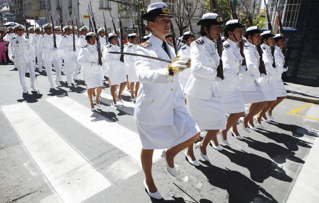 Naval officers march in the parade honoring Abaroa, who died in the 1879-1884 War of the Pacific, as part of Sea Day celebrations in La Paz, Bolivia, on March 23, 2014. Bolivia lost its access to the Pacific due to Chile's victory in the war that gave Chile mineral-rich territories once held by Peru and Boliva. (Photo by Juan Karita/Associated Press)