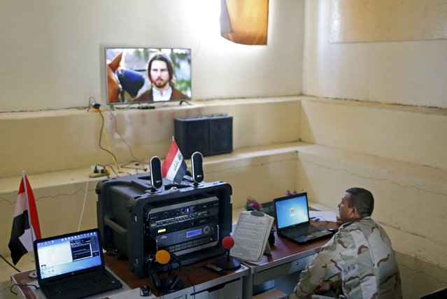 An Iraqi soldier works at a radio station at Makhmour base, Iraq April 17, 2016. (Photo by Ahmed Jadallah/Reuters)