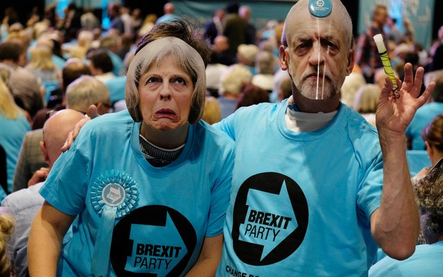 Brexit Party supporters wear masks depicting politicians Jeremy Corbyn and Theresa May as they attend the party's Big Vision Rally at the National Exhibition Centre on June 30, 2019 in Birmingham, England. Organisers have said they are expecting 5000 attendees as the leadership unveiled the first 100 plus prospective parliamentary candidates who have been selected for any future Westminster elections. (Photo by John Robertson/The Telegraph)