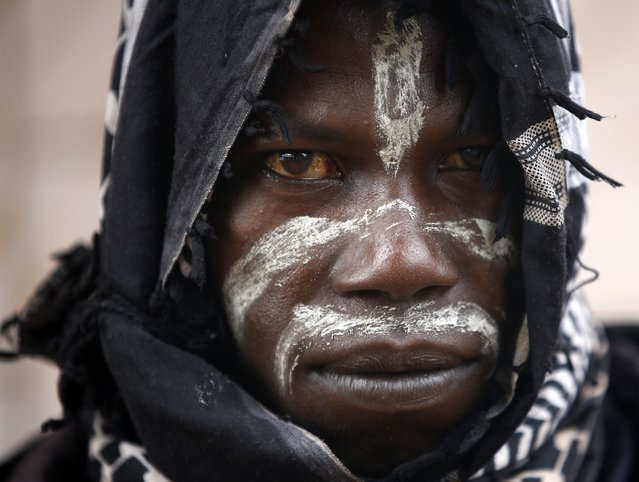 A member of the anti-balaka, a Christian militia, looks on in the village of Zawa April 8, 2014. (Photo by Goran Tomasevic/Reuters)