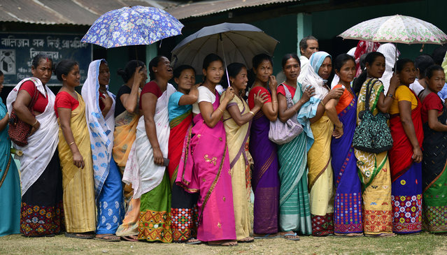 Indian voters wait to cast their votes at a polling station during the first phase of the Indian general election in Lakhimpur district, Assam state, India, April 7, 2014. Voters in India's remote north-eastern states of Assam and Tripura were casting their ballots in the first phase of the country's general elections. Polls were taking place in five of Assam's 14 constituencies and one of two constituencies in Tripura, in the first of nine phases of voting. (Photo by EPA)