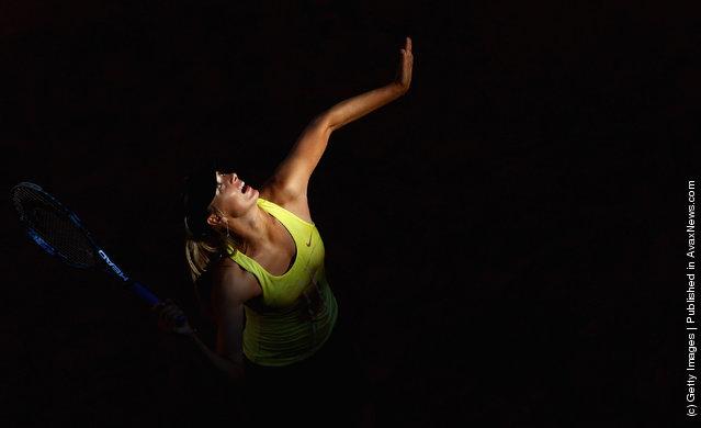 Maria Sharapova of Russia serves during her semi final match against Caroline Wozniacki of Denmark
