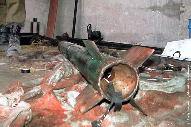 A Palestinian Qassam rocket lies on the floor of a weapons factory discovered by the Israeli army
