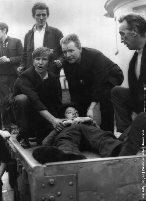 1969:  5 Catholics are killed, 60 injured and hundreds of homes devastated when armed British soldiers impose a curfew in the Falls Road area of Belfast