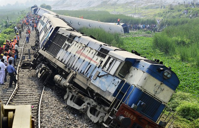 The derailed engine and carriages of the BG Express Train No.15666 at Ajuri station near Morigaon district of Assam state, about 80km away from Guwahati city, India, 16 April 2014. At least 45 people were injured when nine coaches of Dimapur-Kamakhya BG Express derailed in central Assam in the wee hours, a news reports said. (Photo by EPA/STR)