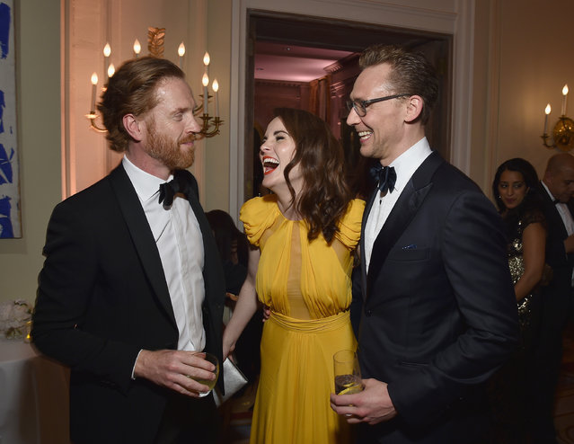 (L-R) Damian Lewis, Michelle Dockery and Tom Hiddleston attend the Bloomberg & Vanity Fair cocktail reception following the 2015 WHCA Dinner at the residence of the French Ambassador on April 30, 2016 in Washington, DC. (Photo by Dimitrios Kambouris/VF16/WireImage)