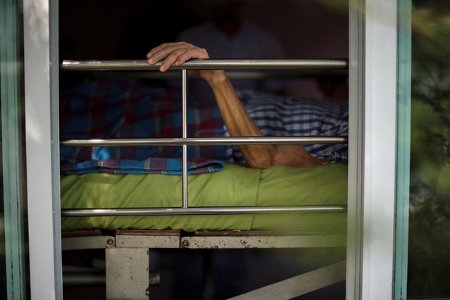 Uthai Sagulpongmalee, 70, lies in bed at Wellness Nursing Home Center in Ayutthaya, Thailand, April 9, 2016. (Photo by Athit Perawongmetha/Reuters)