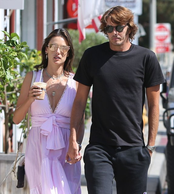 Alessandra Ambrosio looks drop dead s*xy in her low cut pink dress as she and boyfriend Nicolo Oddi step out for lunch at Brentwood Country Mart Wednesday, August 28, 2019. The couple also stopped by Gwyneth Paltrow's Goop store and left with a few goodies. (Photo by X17/SIPA Press)