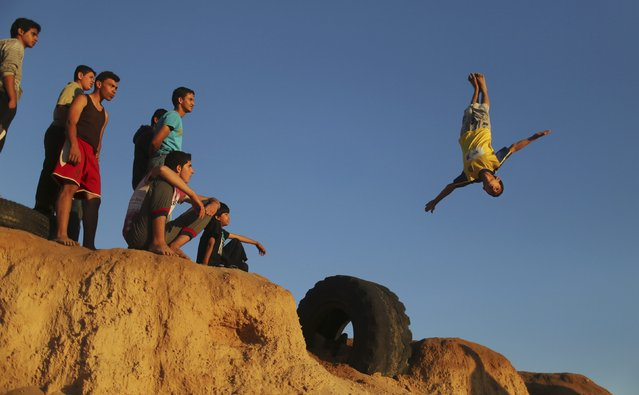A Palestinian youth practices his parkour skills at the Shati refugee camp in Gaza City April 27, 2014. (Photo by Mohammed Salem/Reuters)