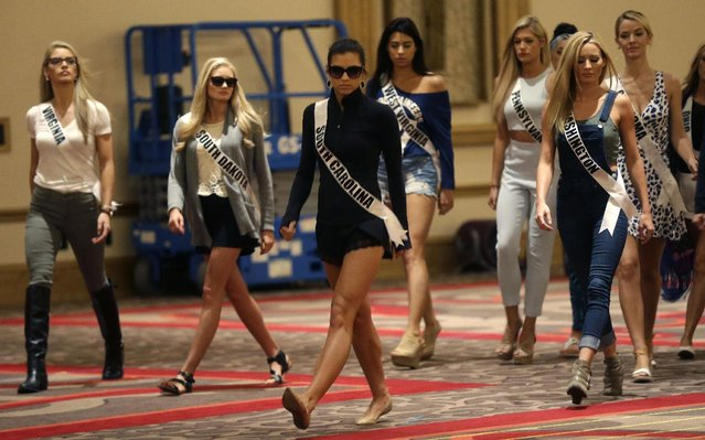 In this Monday, July 6, 2015 photo, contestants rehearse for the upcoming Miss USA Pageant, to be held this week in Baton Rouge, La. Left to right are Miss Virginia Laura Jordan Puleo, Miss South Dakota Lexy Schenk, Miss South Carolina Sarah Weishuhn, Miss West Virginia Andrea Mucino, Miss Pennsylvania Elizabeth Cardillo, Miss Washington Kenzi Novell and Miss Oklahoma Olivia Jordan. (Photo by Gerald Herbert/AP Photo)