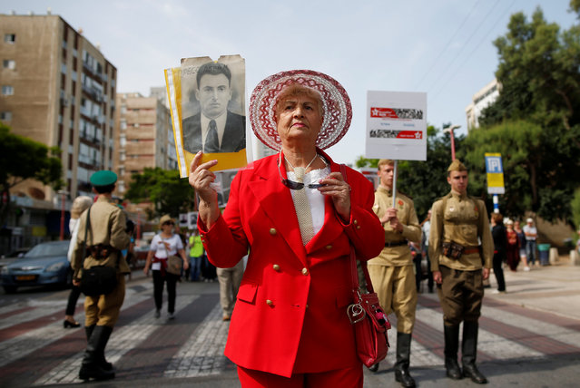 A woman takes part in a march marking Victory Day, the anniversary of the victory of the Allies over Nazi Germany, in Ashdod, Israel, May 9, 2016. (Photo by Amir Cohen/Reuters)