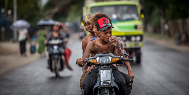 """Freedom"". During my first days in Burma I was traveling in the back of a truck. I look at these boys spending their time in their motorbike. I realized that the feelings during adolesence must be more or less the same everywhere. Photo location: Mandalay, Burma. (Photo and caption by Lenart Gonzalez/National Geographic Photo Contest)"