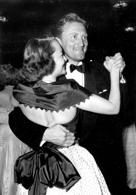 Actress Olivia De Havilland dances with actor Kirk Douglas at the International Cannes Film Festival, April 16, 1953. (Photo by RDA/Getty Images)