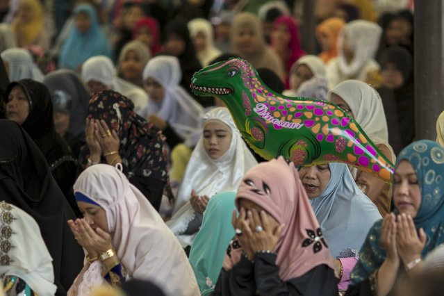 Thai Muslim women attend a mass prayer during Eid al-Fitr celebrations at a mosque in Bangkok, Thailand, July 17, 2015. (Photo by Athit Perawongmetha/Reuters)