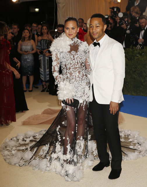"""John Legend and Chrissy Teigen attend """"Rei Kawakubo/Comme des Garcons: Art Of The In-Between"""" Costume Institute Gala – Arrivals at Metropolitan Museum of Art on May 1, 2017 in New York City. (Photo by Carlo Allegri/Reuters)"""