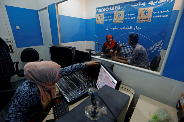 People are seen at a Radio Web studio during training at a youth centre in Ben Guerdane, Tunisia April 12, 2016. (Photo by Zohra Bensemra/Reuters)
