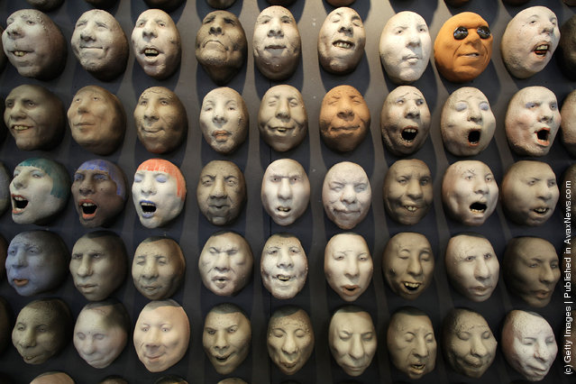 Pottery heads by artist Johan Thunell are displayed at The Affordable Art Fair