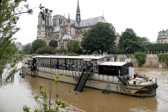 General view of the flooded river-side of the River Seine in central Paris with the Notre-Dame Cathedral in the background, France, June 1, 2016. (Photo by Charles Platiau/Reuters)
