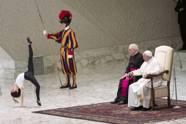 Pope Francis looks at young dancer Jorge Garcia Lamelas performing during an audience with Design for Change children group in the Paul VI hall at the Vatican, Saturday, November 30, 2019. (Photo by Alessandra Tarantino/AP Photo)