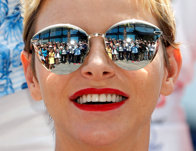 Princess Charlene poses after the arrival of the Riviera Water Bike Challenge in support of the Princess Charlene of Monaco Foundation, in Nice, France, June 4, 2017. (Photo by Eric Gaillard/Reuters)
