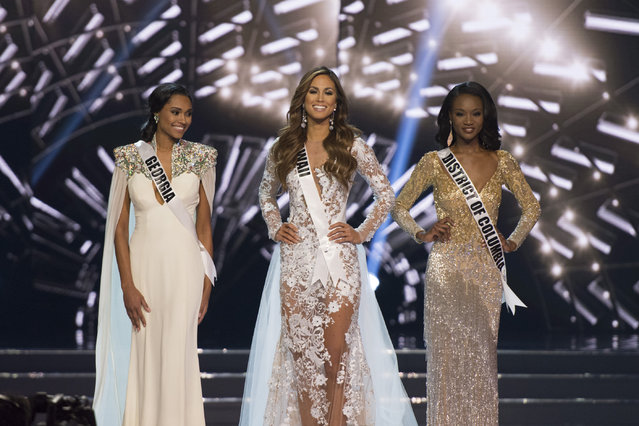 Finalists Miss Hawaii Chelsea Hardin, center, Miss District of Columbia Deshauna Barber, right, and Miss Georgia Emanii Davis, left, stand during the 2016 Miss USA pageant in Las Vegas, Sunday, June 5, 2016. (Photo by Jason Ogulnik/Las Vegas Review-Journal via AP Photo)