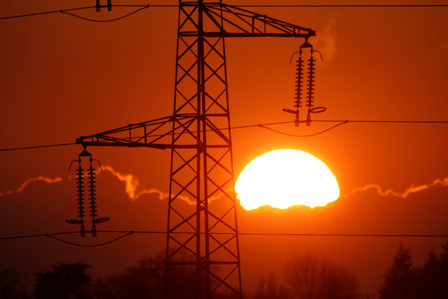 Electrical power pylons of high-tension electricity power lines are seen at sunset in Cambligneul near Arras, France, February 15, 2017. (Photo by Pascal Rossignol/Reuters)