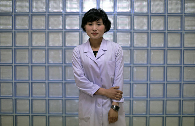 """In this May 7, 2016, photo, Kim Una, 23, studying to be an obstetrician at the Pyongyang Maternity hospital, poses for a portrait in Pyongyang, North Korea. She enjoys the work because it is about """"bringing new life into the world"""". She hopes to """"meet a good man and have five children with him"""". (Photo by Wong Maye-E/AP Photo)"""