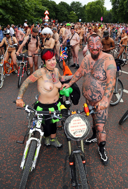 World Naked Bike Ride, London, Britain, 14 June 2014. (Photo by Paul Brown/Rex Features)