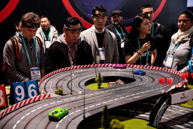 Visitors test Brainco's model race cars racing using their brainwaves to make the cars start and accelerate, during the 2020 International Consumer Electronics Show at the Convention Center in Las Vegas, Nevada, USA, 07 January 2020. The annual CES which takes place from 07 to 10 January is a place where industry manufacturers, advertisers and tech-minded consumers converge to get a taste of new innovations coming to the market each year. (Photo by Etienne Laurent/EPA/EFE)