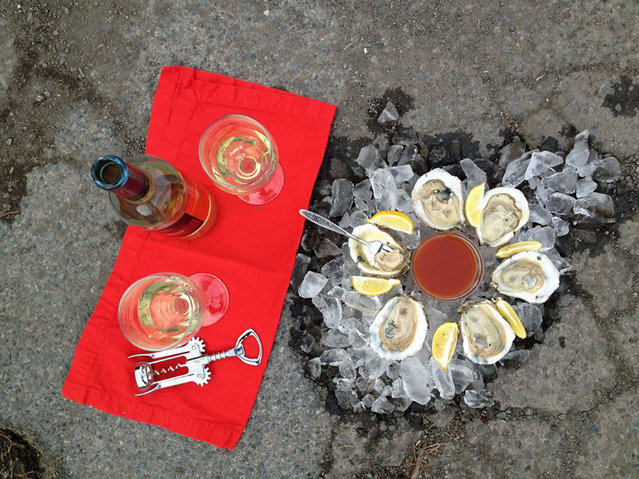 Funny pothole art: Fresh oyster pothole. (Photo by Caters News)