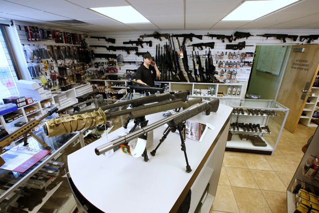 """Sniper rifles sit on display for sale at the """"Ready Gunner"""" gun store in Provo, Utah, U.S., June 21, 2016. (Photo by George Frey/Reuters)"""